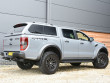 Ford Ranger Raptor in Conquer with a leisure hard top fitted